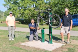 Waterford trail team installing the bike station